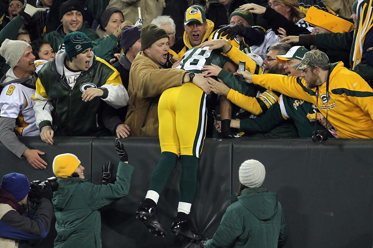 GREEN BAY, WI - NOVEMBER 14:  Randall Cobb #18 of the Green Bay Packers celebrates with fans after he scored n a 80-yard punt return in the first quarter against the Minnesota Vikings at Lambeau Field on November 14, 2011 in Green Bay, Wisconsin.  (Photo by Jonathan Daniel/Getty Images)