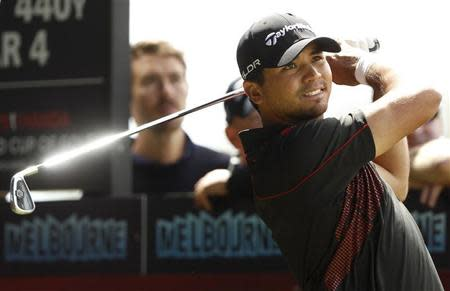 Day plays a tee shot on the 12th hole during the final round of the World Cup of Golf in Melbourne