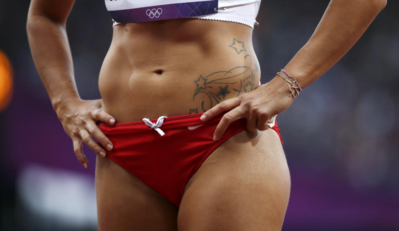 The tattoo of Lebanon's Gretta Taslakian is seen during her women's 200m round 1 heat at the London 2012 Olympic Games at the Olympic Stadium August 6, 2012. REUTERS/Lucy Nicholson (BRITAIN  - Tags: OLYMPICS SPORT ATHLETICS)
