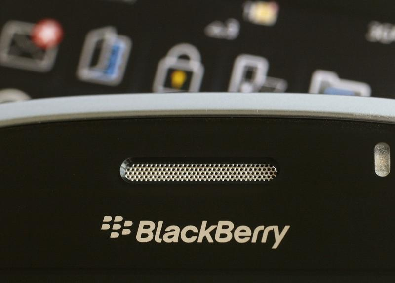 An illustrative photo shows Blackberry smartphone