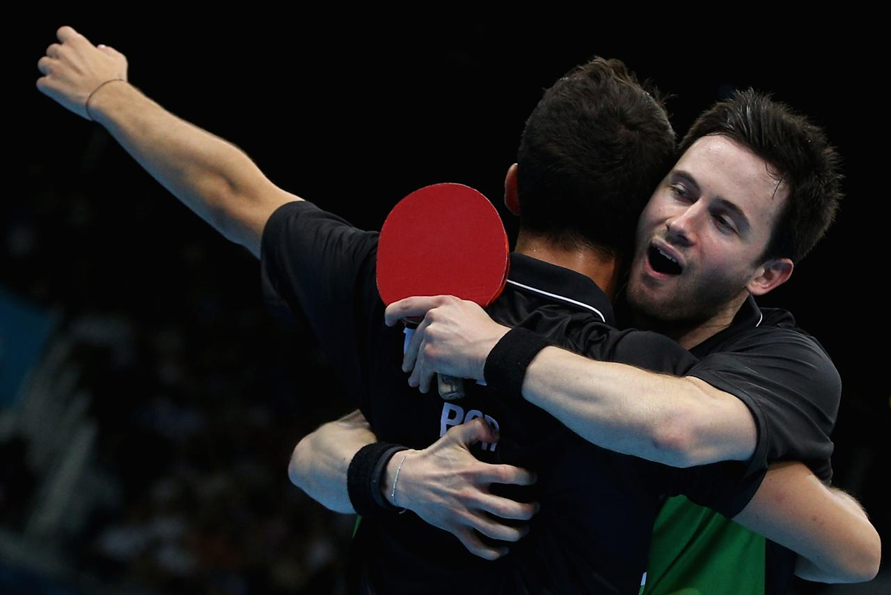 LONDON, ENGLAND - AUGUST 03:  Joao Monteiro and Tiago Apolonia of Portugal celebrate during Men's Team Table Tennis first round match against team of Great Britain on Day 7 of the London 2012 Olympic Games at ExCeL on August 3, 2012 in London, England.  (Photo by Feng Li/Getty Images)