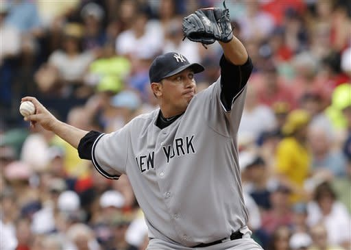New York Yankees starting pitcher Freddy Garcia delivers to the Boston Red Sox in the third inning of the first baseball game of a day-night doubleheader at Fenway Park in Boston, Saturday, July 7, 2012. (AP Photo/Elise Amendola)
