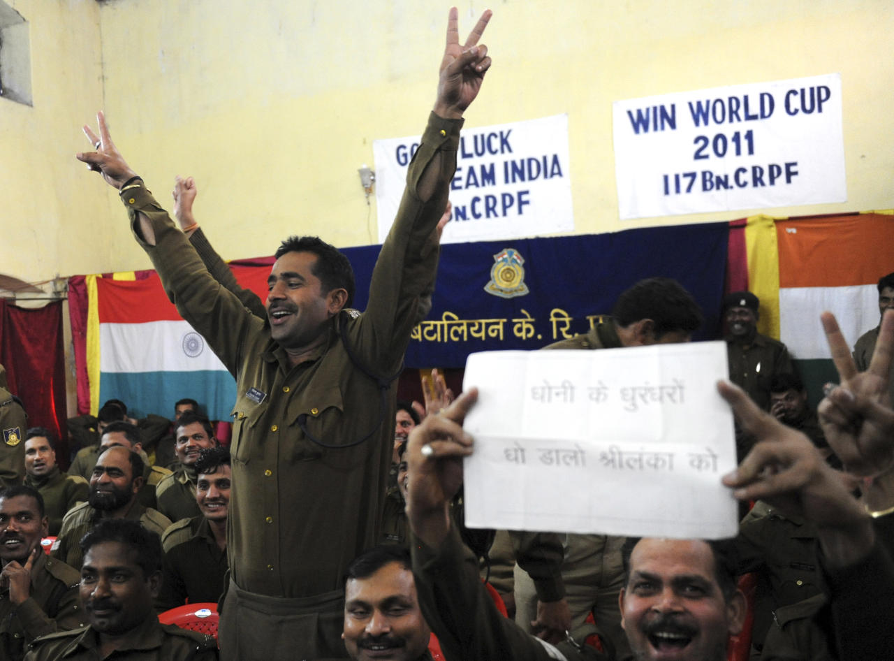 Indian Central Reserve Police Force (CRPF) soldiers gesture and shout slogans at their base in Srinagar on April 2, 2011, as they watch the Cricket World Cup 2011 final between India and Sri Lanka from Mumbai. AFP PHOTO/Rouf BHAT (Photo credit should read ROUF BHAT/AFP/Getty Images)