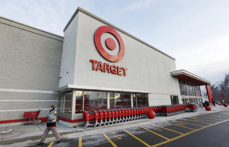 Target scales back on health coverage
