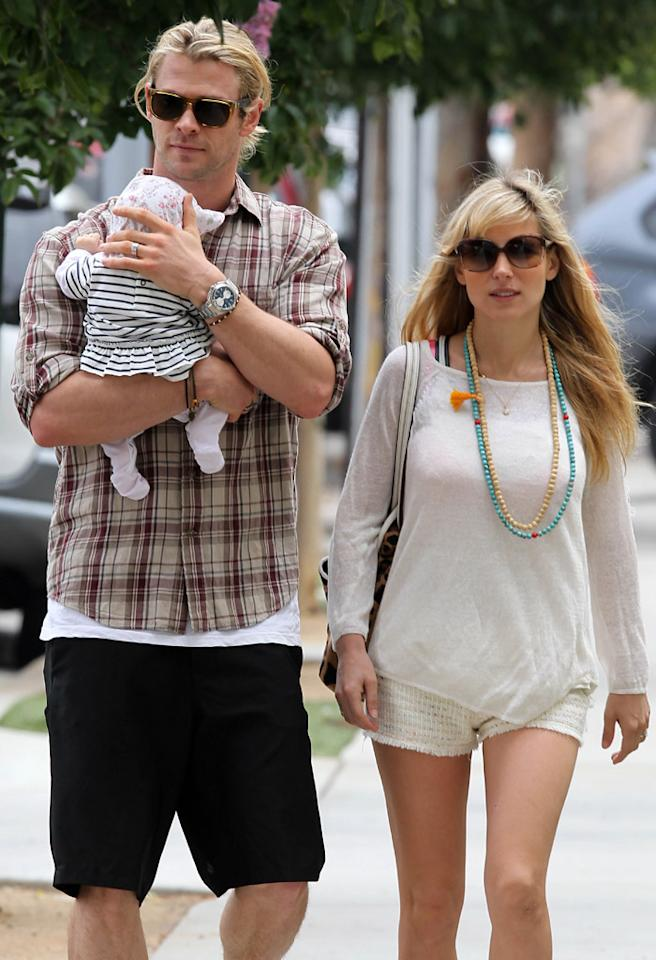 Chris Hemsworth takes baby India and wife Elsa Pataky for a walk around Santa Monica. Pictured: Chris Hemsworth, India Hemsworth and Elsa Pataky  Ref: SPL419367  210712  Picture by: Clint Brewer / Splash News   Splash News and Pictures Los Angeles:310-821-2666 New York:212-619-2666 London:870-934-2666 photodesk@splashnews.com