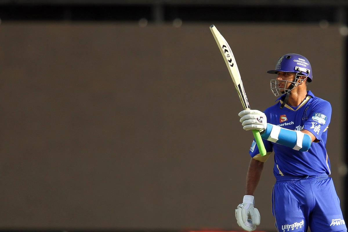 Rajasthan Royals captain Rahul Dravid raises his bat after reaching his fifty during match 4 of the Pepsi Indian Premier League between Delhi Daredevils and the Rajasthan Royals held at the Feroz Shah Kotla Stadium, Delhi on the 6th April 2013..Photo by Shaun Roy-IPL-SPORTZPICS ..Use of this image is subject to the terms and conditions as outlined by the BCCI. These terms can be found by following this link:..http://www.sportzpics.co.za/image/I0000SoRagM2cIEc