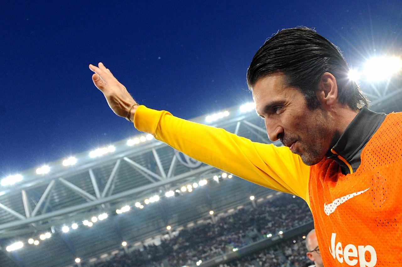 Juventus goalkeeper Gianluigi Buffon waves to supporters prior tot the start of a Serie A soccer match between Juventus and Atalanta at the Juventus stadium, in Turin, Italy, Monday, May 5, 2014. (AP Photo/Massimo Pinca)