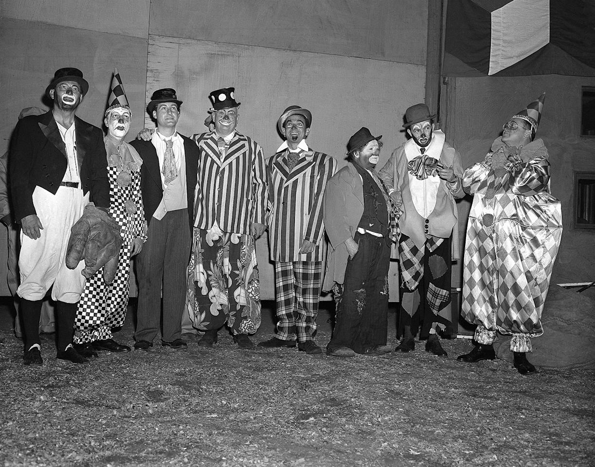 "<p>Seven of these eight costumed clowns are radio and television personalities, while the eighth (third from right) is Otto Griebling, who earns his livelihood as a clown with Ringling Brothers and Barnum and Bailey Circus. Group gathered at New York's Madison Square Garden, April 1, 1953 for opening performance of ""The Greatest Show On Earth."" From left are: Al Schacht, perennial baseball clown; Garry Moore, Sid Caesar, Lauritz Melchior, Jack Carter, Otto Griebling, Herb Shriner and Sam Levenson. The radio and TV personalities participated in the opening night performance with proceeds going to United Cerebral Palsy of New York. (AP Photo/Matty Zimmerman) </p>"