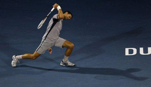 Serbia's Novak Djokovic returns the ball to Czech Republic's Tomas Berdych during their ATP Dubai Open tennis final match in the Gulf emirate on March 2, 2013. Djokovic claimed the Dubai Open title for the fourth time on Saturday, beating Berdych 7-5, 6-3
