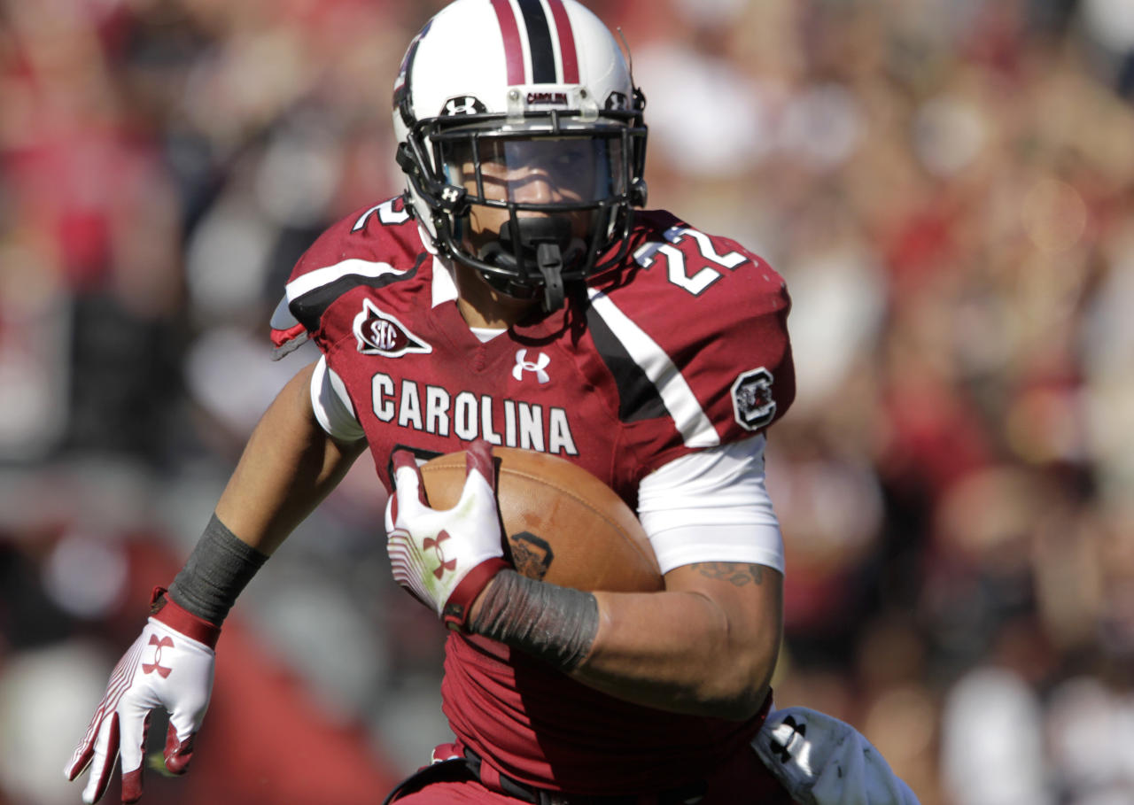 South Carolina running back Brandon Wilds rushes for a first down during the second quarterof a NCAA college football game against Florida at Williams-Brice Stadium, in Columbia, S.C., Saturday, Nov. 12, 2011.  (AP Photo/Brett Flashnick)