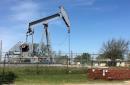 Oil up on lower US stocks, firmer demand