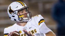 Wyoming QB Josh Allen goes through senior day festivities