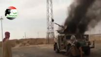 Raw: Iraqi Army Troops Flee Base in Tikrit