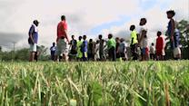 Ex-NFL Player Tackles Overgrown Field For Kids