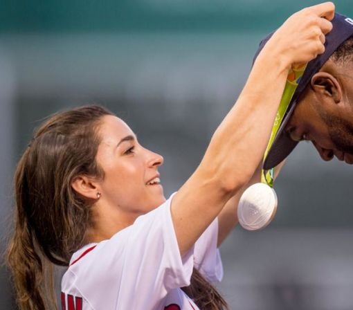 David Ortiz wears Aly Raisman's Olympic medals during fun first pitch