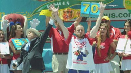 Joey Chestnut eats 70 hot dogs to reclaim championship ti...