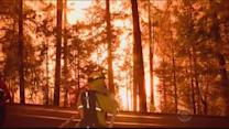 Thousands of firefighters battle raging Calif. fires