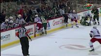 Wild analyst Mike Greenlay gets hit by stick