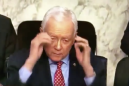Senator reaches for nonexistent glasses and takes them off anyway