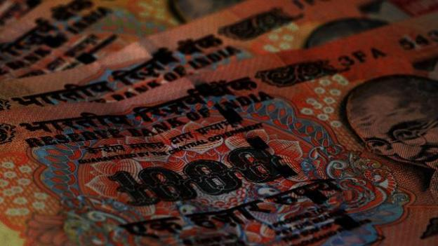 Rupee trims initial gains, 15 paise up