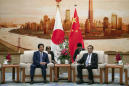 Japan's Abe in China as 2 nations try to mend ties
