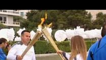 Olympic flame passed to UK