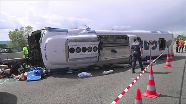 Romanian bus overturns in France, infant dead, 35 injured
