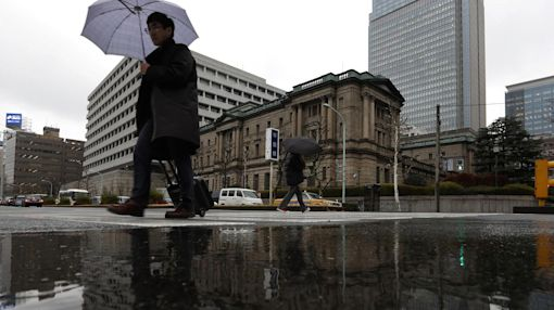 Stocks end under pressure on mixed earnings; BOJ eyed