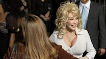 Parton to perform at Glastonbury, Tomlinson plays soccer
