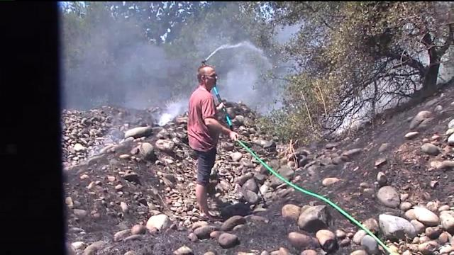 Neighbors Fought Wildfire With Garden Hoses