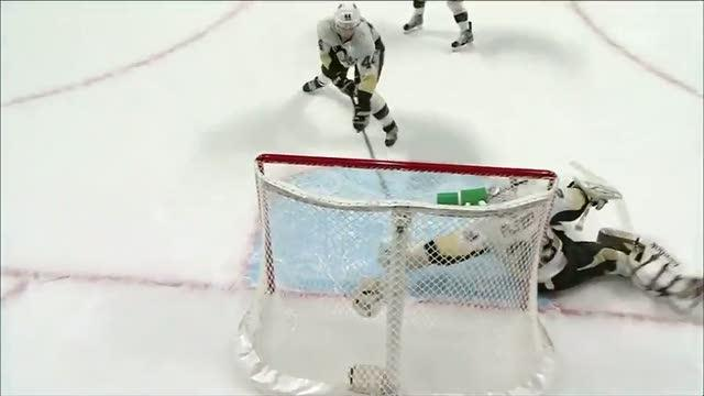 Brooks Oprik sweeps a puck out of the crease