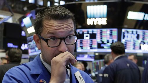 US stocks wobble as phone companies fall, oil prices jump