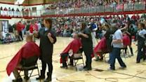 Community shaves head for student with brain tumor