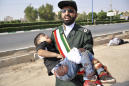The Latest: Boy wounded in Iran parade attack has died