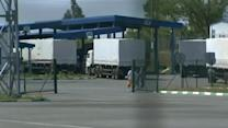 Russian convoy crosses into Ukraine