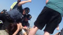 Video Shows Police Officer Punching Woman On New Jersey Beach