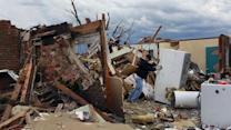 Victims begin to assess damage from devastating tornado