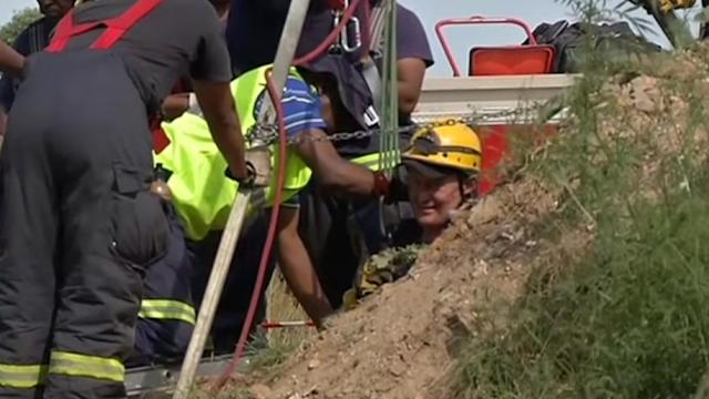S. African rescuers try to reach more than 200 trapped illegal miners