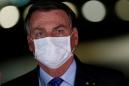Nearly half of Brazilians say Bolsonaro not to blame for coronavirus death toll, poll says