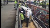 Car smashes through barrier into London subway