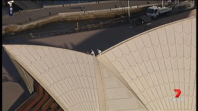 Man scales Sydney Opera House