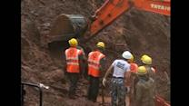 Crews work to find villagers swallowed up in landslide in India