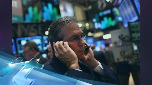 Warnings of slower sales sends Dow down 200 points