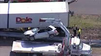 Crane lifts car after crash with tractor trailer in Cherry Hill
