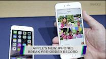 Apple's new iPhones break pre-order record; RadioShack shares rally after CFO resigns; Yahoo continues to rise ahead of Alibaba IPO