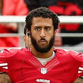 Colin Kaepernick says he'll 'continue to sit' during national anthem