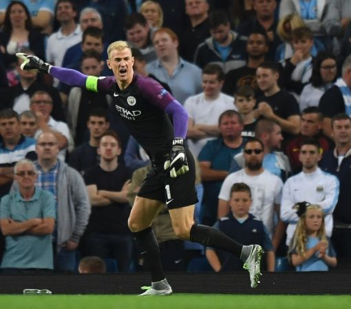 Fans hail Hart as Man City reach group phase