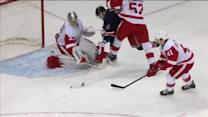 Jimmy Howard gets a toe out to rob Rick Nash