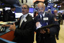 Stocks post small losses; investors look ahead to Fed
