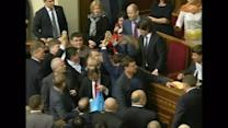 Ukraine opposition deputies toss buckwheat at MP